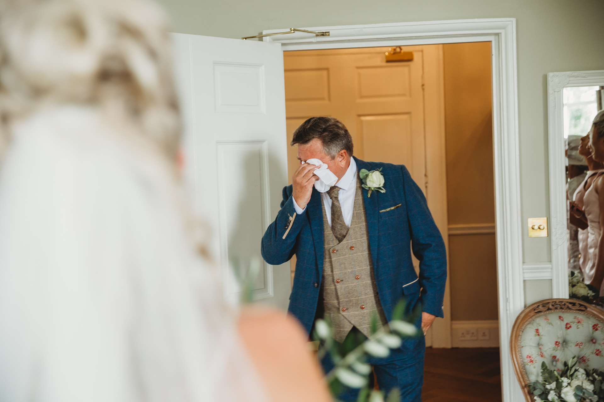 father of the bride entering room and seeing bride, crying
