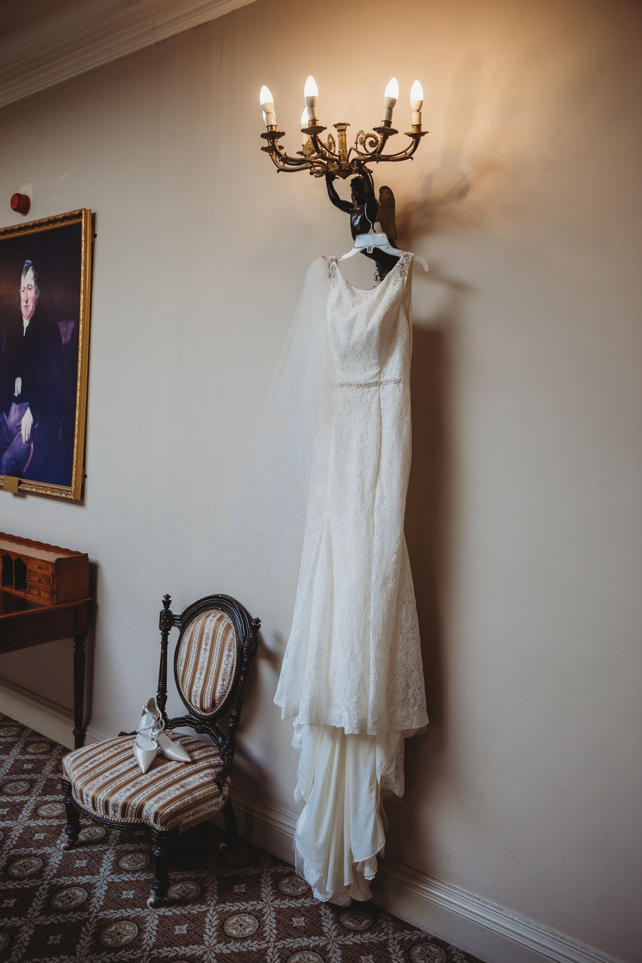 wedding dress hanging in the hall