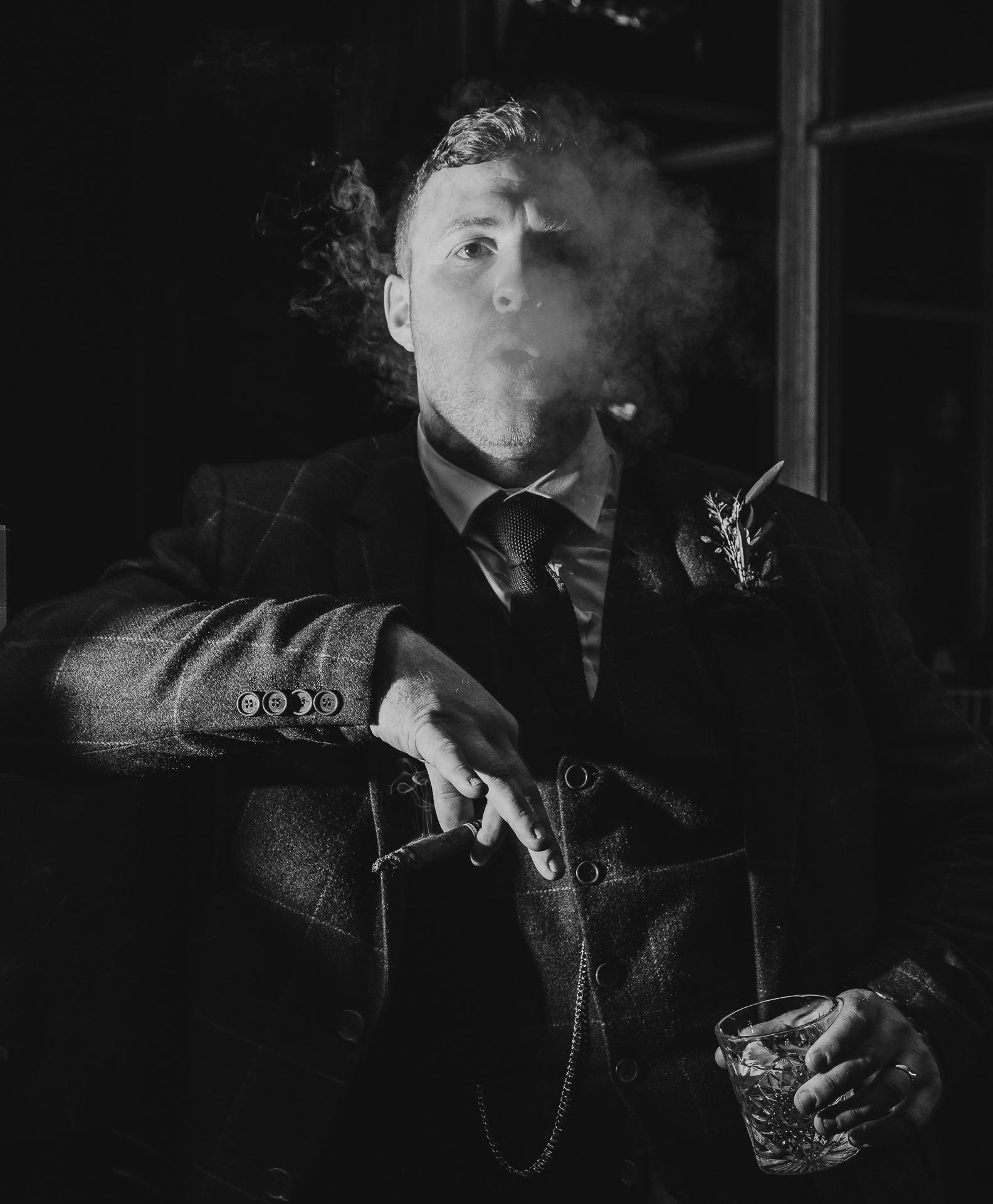 Groom smoking a cigar Newton hall wedding photographer