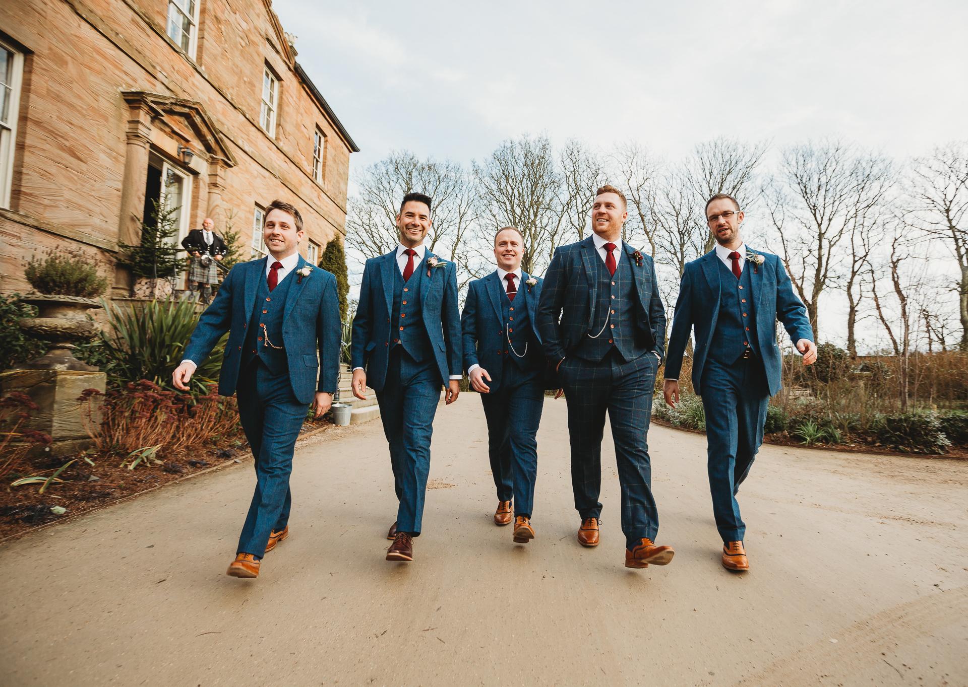 groomsmen walking newton hall wedding