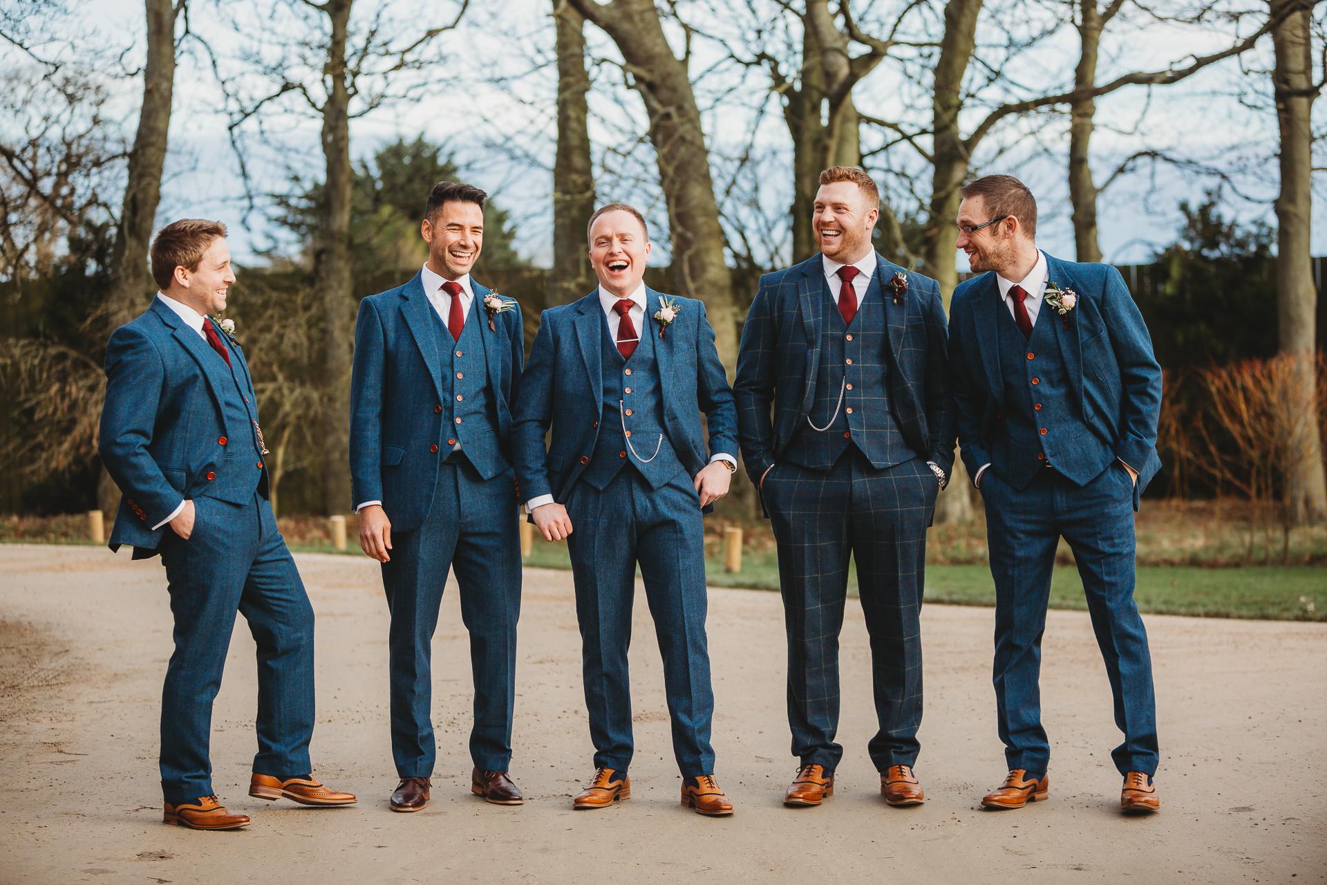 laughing groomsmen Newton hall wedding