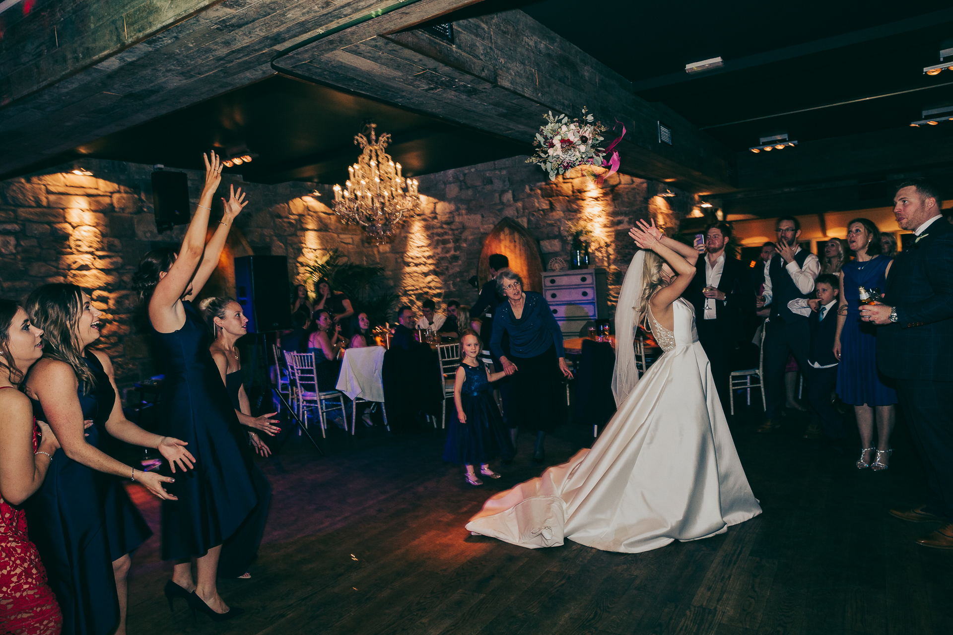 throwing of the bouquet, Newton Hall wedding photographer