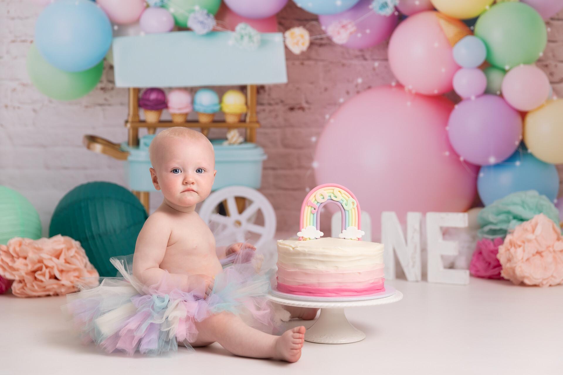 Cake smash Photography, pink balloons and rainbow tutu